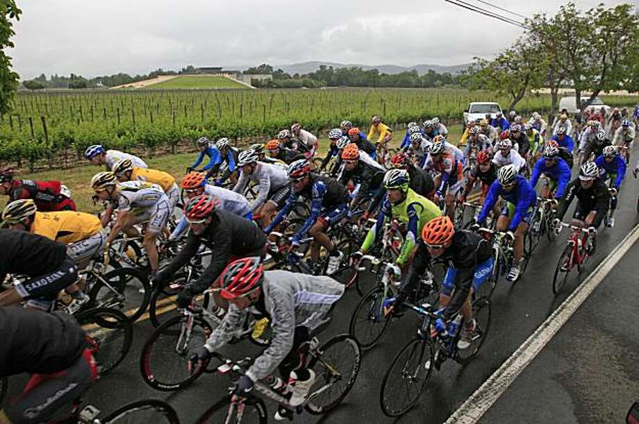 The peloton makes its way past vineyards and the Opus One winery in the Napa Valley during the second stage of the Amgen Tour of California bicycle race in Oakville, Calif., Monday, May 17, 2010. (AP Photo/Eric Risberg) France 2010 Photo: Eric Risberg, AP