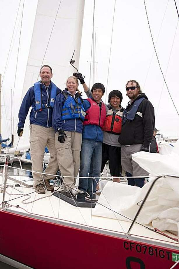 California 1 team, l-r, Al Spector (team tactician and owner Marin Sailing School, Sausalito), Danette Davis (team trimmer and director of Marin Sailing School's Program for the Blind), blind sailor blind sailor Mitsuhiro Iwamoto (team driver, San Diego),blind sailor Philip Kum (team mainsheet trimmer, San Francisco) prepare for a full day of sailing at the California Invitational Blind Regatta (Alameda, May 14-16). Photo: Marc Fiorito, Gamma Nine Photography