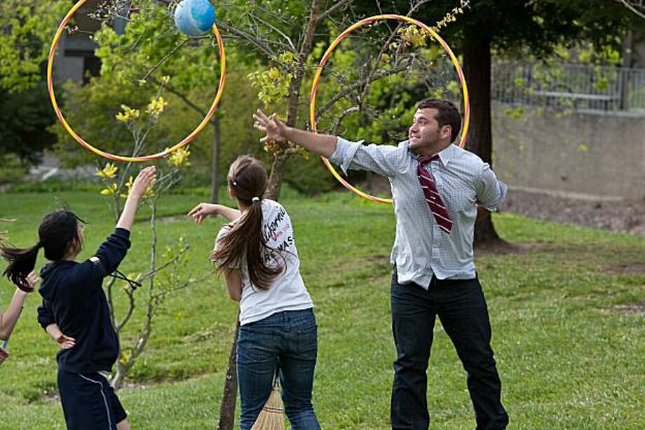 L to R: Sarah Tang,  Rosie Havener and Charlie Strauss play Quidditch at UC Berkeley. Photo: Drake Martinet, Special To The Chronicle