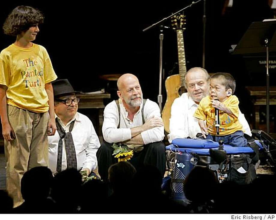 "From left, Danny DeVito, Bruce Willis, and Jack Nicholson listen to thanks from a young boy during the curtain call for the staged reading of ""The World of Nick Adams,"" to benefit the Painted Turtle, Paul Newman's Hole in the Wall California Camp, at the Davies Symphony Hall in San Francisco, Monday, Oct. 27, 2008. The Painted Turtle is an innovative camp and family care center for children with life-threatening illnesses. Photo: Eric Risberg, AP"