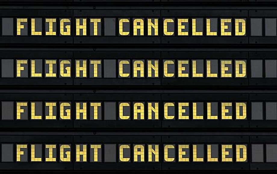 A departures board showing canceled flights at Newcastle International Airport, England, Sunday May 16, 2010. Civil aviation officials say a drifting, dense cloud of volcanic ash is encroaching on British airspace, forcing the closure of airports in Northern Ireland, Scotland, and much of England. Photo: Scott Heppell, AP