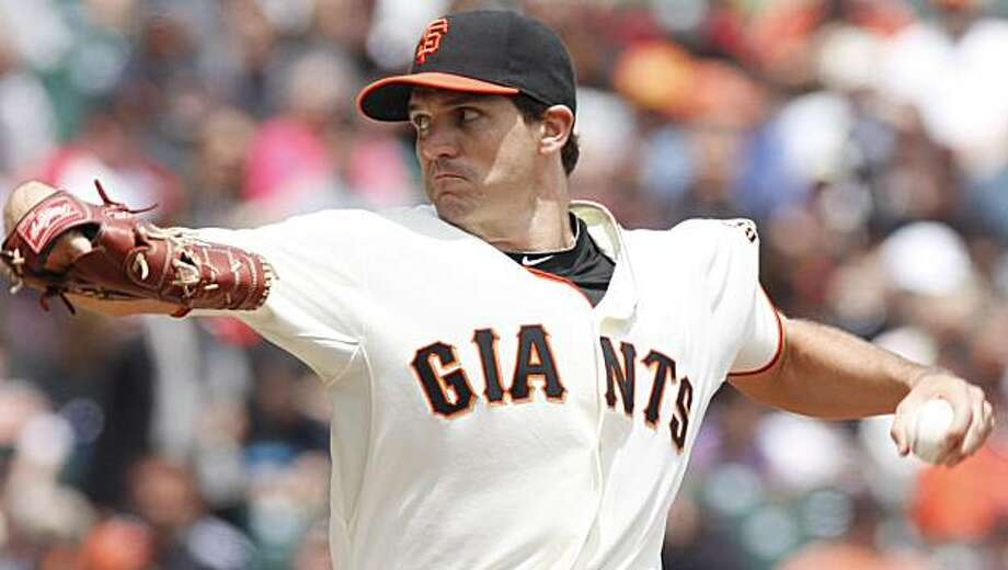 San Francisco Giants pitcher Barry Zito throws to the Houston Astros during the first inning of a baseball game on Sunday, May 16, 2010, in San Francisco. The Giants defeated the Astros 4-3 and Zito got his sixth win of the season. Photo: George Nikitin, AP