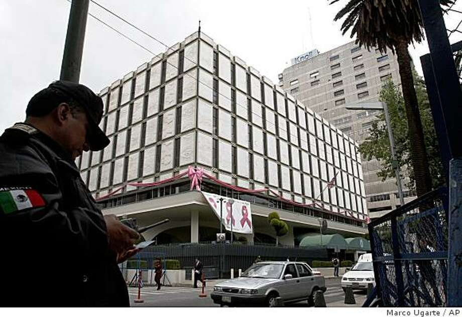 A policeman stands in front of the U.S. Embassy in Mexico City, Monday, Oct. 27, 2008. A major Mexican drug cartel has infiltrated the Mexican attorney general's office, and one cartel worker said he even spied on DEA operations from inside the U.S. Embassy, according to Mexican prosecutors.(AP Photo/Marco Ugarte) Photo: Marco Ugarte, AP