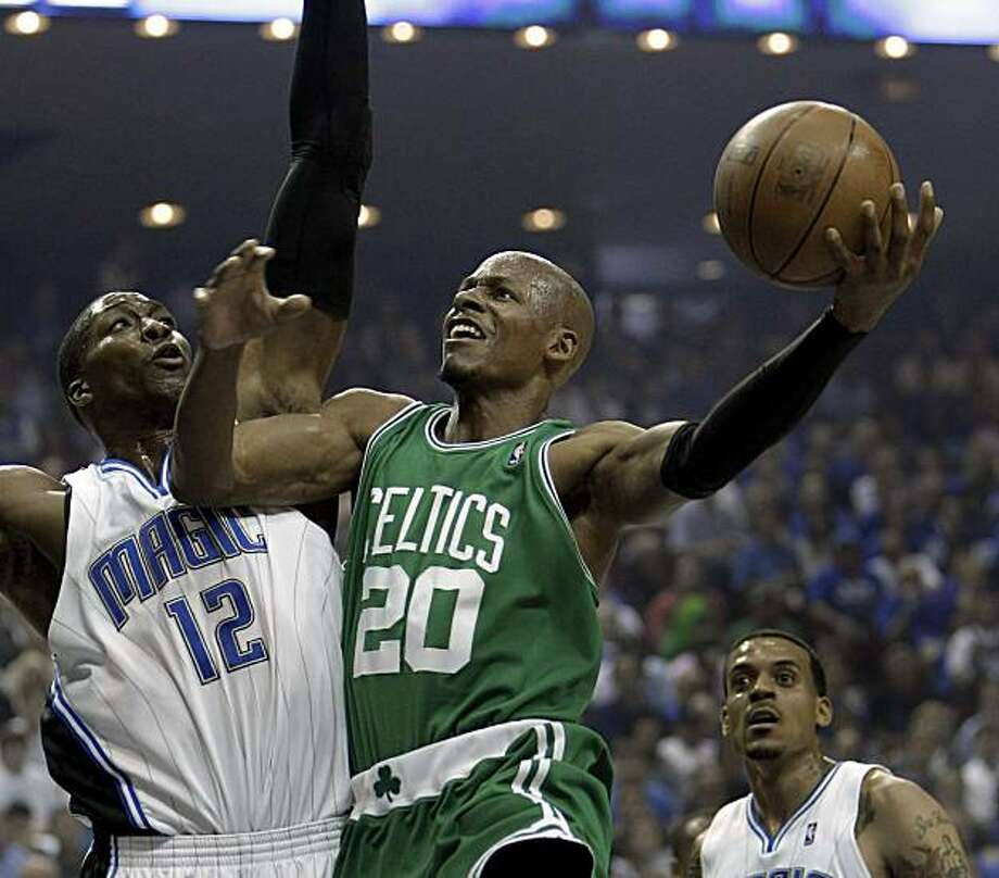 Boston Celtics guard Ray Allen (20) shoots over Orlando Magic center Dwight Howard (12) during the first half in Game 1 of the NBA Eastern Conference basketball finals in Orlando, Fla., Sunday, May 16, 2010. Photo: John Raoux, AP