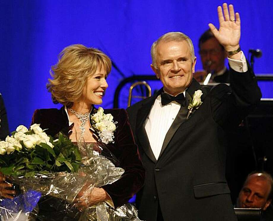 Nevada Gov. Jim Gibbons, right, and his wife Dawn are introduced at the Nevada Inaugural Ball at the Venetian Hotel and Casino in Las Vegas on Friday, Jan. 26, 2007. (AP Photo/Isaac Brekken) Photo: Isaac Brekken, AP