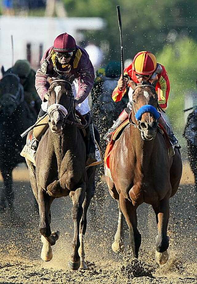 BALTIMORE - MAY 15:  Lookin At Lucky (center), ridden by Martin Garcia #7,holds off Jackson Bend , ridden by Mike Smith #6, down the homestrech to win the 135th running of the Preakness Stakes at Pimlico Race Course on May 15, 2010 in Baltimore, Maryland. Photo: Jim McIsaac, Getty Images