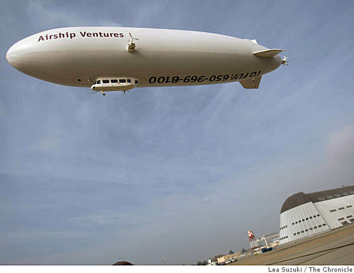 A German-made Zeppelin, brought over by Airship Ventures, flies above Moffett Field in Mountain View, Calif.
