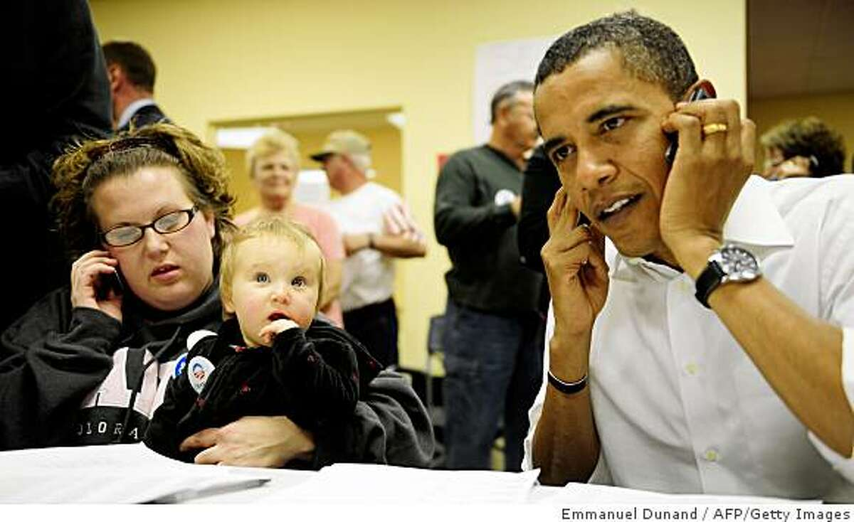 US Democratic presidential candidate Illinois Senator Barack Obama helps to make phone calls with volounteers to gather votes, at his campaign office in Brighton, Colorado, October 26, 2008. AFP PHOTO/Emmanuel Dunand (Photo credit should read EMMANUEL DUNAND/AFP/Getty Images)