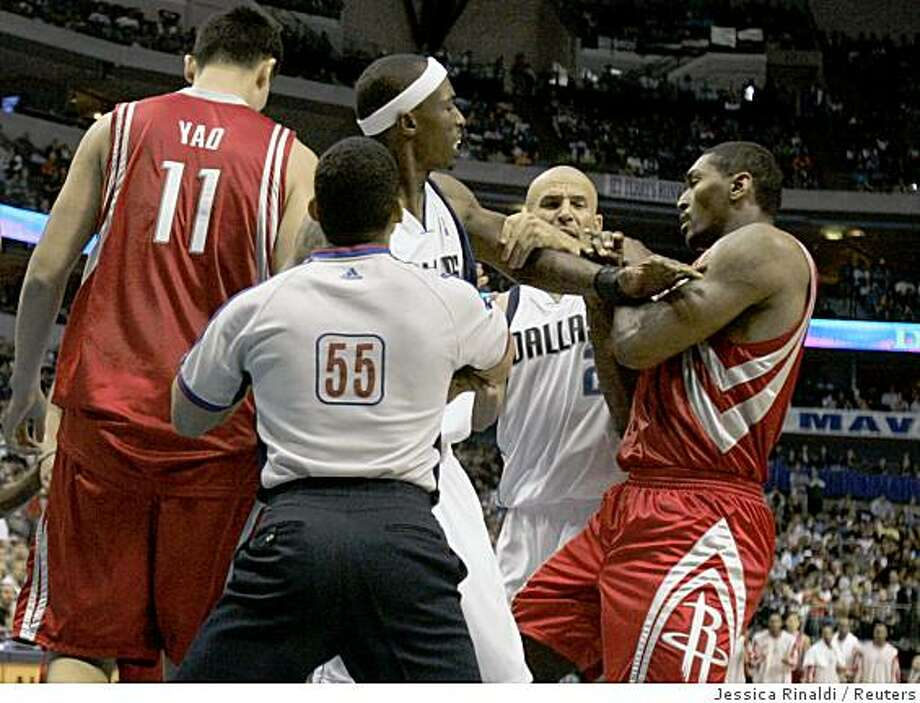 Houston Rockets Ron Artest (R) pushes Dallas Mavericks Josh Howard (L) as Jason Kidd (C) attempts to break up the fight after Howard fouled Yao Ming in second half in Dallas, Texas October 30, 2008. Photo: Jessica Rinaldi, Reuters