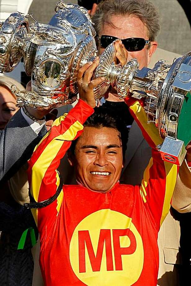 BALTIMORE - MAY 15:  Jockey Martin Garcia celebrates in the winners circle after riding Lookin at Lucky to win during the 135th Preakness Stakes at Pimlico Race Course on May 15, 2010 in Baltimore, Maryland. Photo: Matthew Stockman, Getty Images