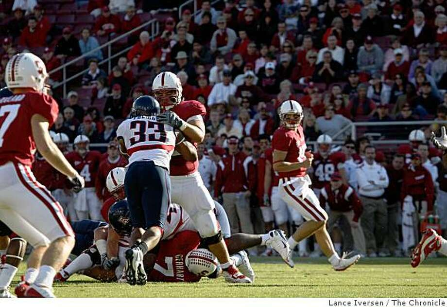 Stanford Center Alex Fletcher steps up to block Arizona Linebacker Ronnie Palmer(33) to lead the Stanford Cardinal to a 24-23 win over the Arizona Wildcats in a Pac-10 Conference showdown at Stanford Stadium on October 11, 2008. Photo: Lance Iversen, The Chronicle