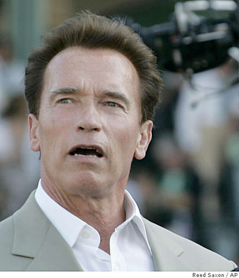 California Governor Arnold Schwarzenegger and actor Kurt Russell, right, talk during the Breeders' Cup Classic horse race at Santa Anita Park in Arcadia, Calif., Saturday, Oct. 25, 2008.  (AP Photo/Reed Saxon) Photo: Reed Saxon, AP