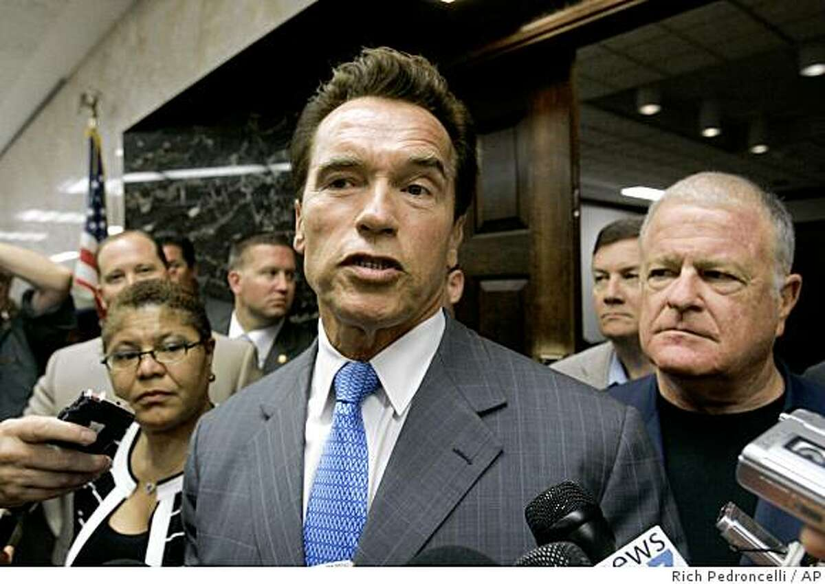 Gov. Arnold Schwarzenegger announces that he would call the Legislature into a special session to deal with the looming state budget crisis, outside his Capitol office in Sacramento, Calif., Monday, Oct. 27, 2008. Schwarzenegger, flanked by Assembly Speaker Karen Bass, of Los Angeles, left, Senate Minority Leader Dave Cogdill, of Modesto, second from right, and state Senate President Pro Tem Don Perata, of Oakland, right, said he would call lawmakers in for a special session immediately after the Nov. 4 elections.(AP Photo/Rich Pedroncelli)