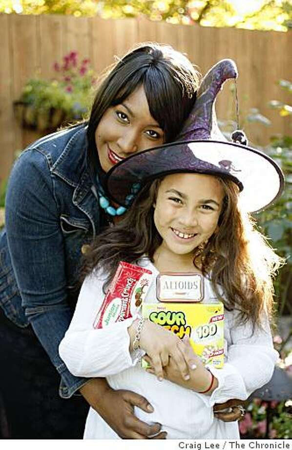 Mireille Schwartz and her 8-year-old daughter, Charlotte Jude, who is allergic to nuts, are preparing for Halloween nut-free trick or treat for her daughter, in San Francisco, Calif., on October 21, 2008. She is holding some nut-free treats. Photo: Craig Lee, The Chronicle