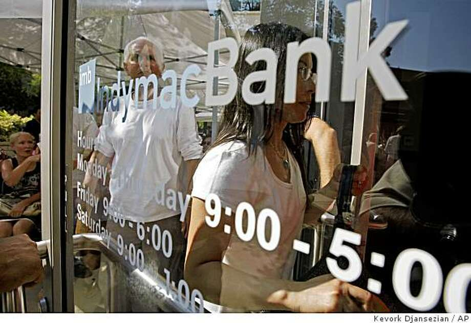 **FILE** In this July 14, 2008 file photo, customers of IndyMac Federal Bank enter the failed financial institution's headquarters in Pasadena, Calif. The most ambitious effort to help troubled homeowners isn't coming out of the private sector. It's coming from failed IndyMac Bank. Under the control of the Federal Deposit Insurance Corp., the California lenders borrowers are getting their interest rates lowered to as low as 3 percent for five years.  (AP Photo/Kevork Djansezian, file) Photo: Kevork Djansezian, AP