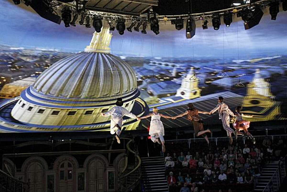 """Peter Pan takes the Darling children on their trip to Never Never land, which is projected as European landmarks on the tent. """"Peter Pan"""" with wrap-around productions inside a 360 degree tent in San Francisco, Calif. is about to make its U.S. debut."""