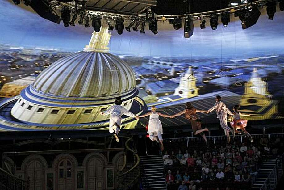 "Peter Pan takes the Darling children on their trip to Never Never land, which is projected as European landmarks on the tent. ""Peter Pan"" with wrap-around productions inside a 360 degree tent in San Francisco, Calif. is about to make its U.S. debut. Photo: Brant Ward, The Chronicle"