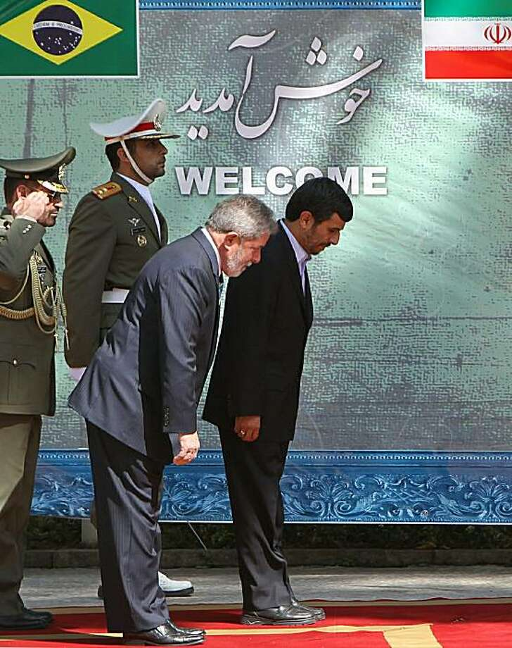 Iranian President Mahmoud Ahmadinejad (R) and his Brazilian counterpart Luiz Inacio Lula da Silva (2nd R) review an honour guard during a welcoming ceremony for the latter at the presidential offices in Tehran on May 16, 2010. Lula, who heads a 300-strongdelegation, is visiting the Islamic republic for a nuclear summit that major powers have said might prove to be Tehran's last chance to avoid new UN sanctions. Photo: Atta Kenare, AFP/Getty Images