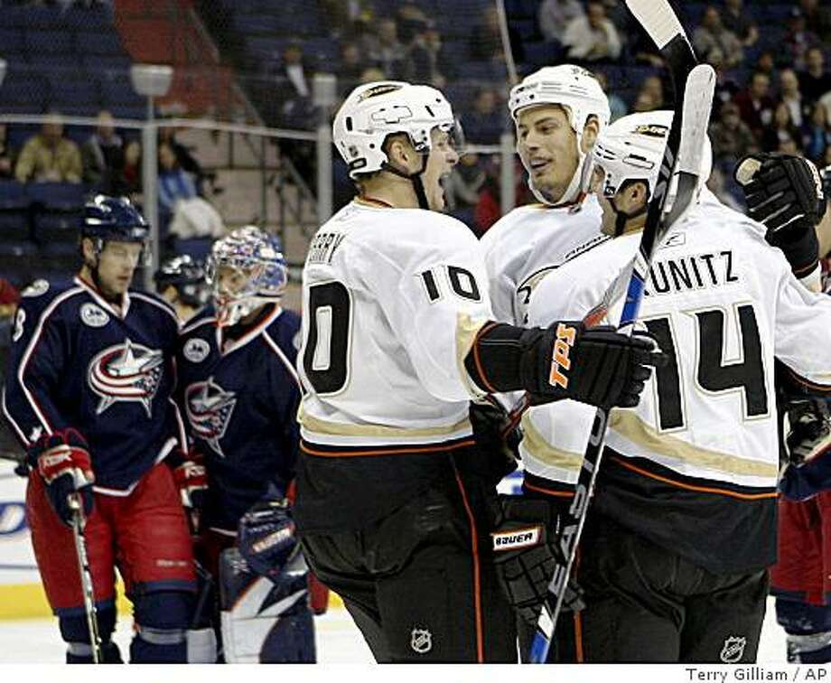 Anaheim Ducks' Corey Perry (10), Ryan Getzlaf, center, and Chris Kunitz (14) celebrate after Getzlaf scored a goal against the Columbus Blue Jackets during the first period of an NHL hockey game Monday, Oct. 27, 2008, in Columbus, Ohio. Blue Jackets' Jan Hejda (8), of the Czech Republic, and goalie Fredrik Norrena, of Finland, are in the background. (AP Photo/Terry Gilliam) Photo: Terry Gilliam, AP