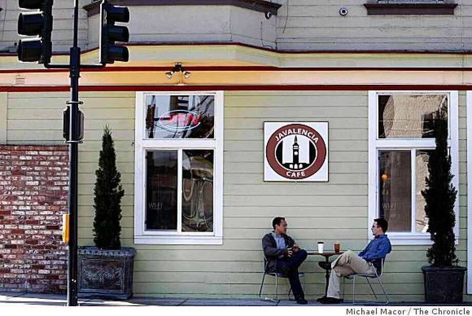 "Pat Vayaphat, left and Jason Stewart are frequent visitors to the ""Javalencia Cafe"" on the corner of 3rd and Fairfax Streets, in San Francisco, Calif. The two sit outside and drink their cups of coffee on Wednesday Oct. 15, 2008. Photo: Michael Macor, The Chronicle"
