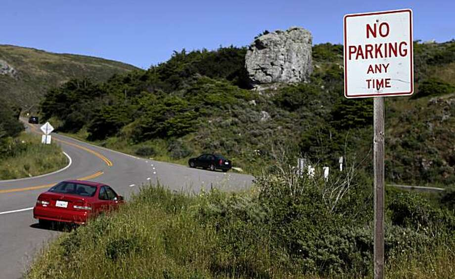 Two cars are parked along the edge of Highway 1 about 1 mile south of Stinson Beach, Saturday May 15, 2010, in Stinson , Calif.  Beach-goers will be in for a shock this summer when they get a $99 ticket  for parking illegally at Stinson, Bolinas or Muir beaches. Photo: Lacy Atkins, The Chronicle