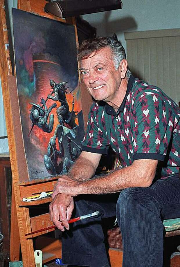 In this Oct. 24, 1994 photo, renowned fantasy artist Frank Frazetta sits next to one of his paintings in East Stroudsburg, Pa. The adult children of pioneering fantasy artist Frank Frazetta have resolved an ugly dispute over control of their elderly father's body of work. Photo: David W. Coulter, AP