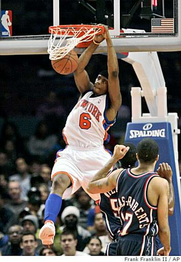 New York Knicks' Patrick Ewing Jr. dunks the ball as New Jersey Nets' Chris Douglas-Roberts looks on during the second half on Friday, Oct. 24, 2008, in New York. The Nets won 111-110. Photo: Frank Franklin II, AP