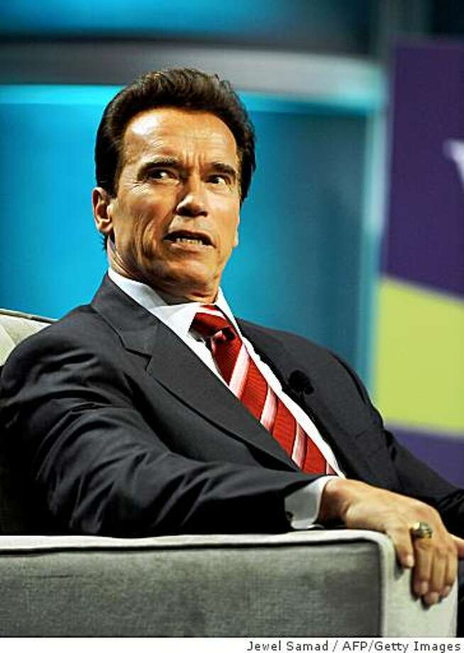 California Governor Arnold Schwarzenegger joins a coversation during the Women's Conference 2008 at the Long Beach Convention Centre in Long Beach, California, on October 22, 2008. Some 14,000 women were attending  the nation's premier forum for women.    AFP PHOTO/Jewel SAMAD (Photo credit should read JEWEL SAMAD/AFP/Getty Images) Photo: Jewel Samad, AFP/Getty Images