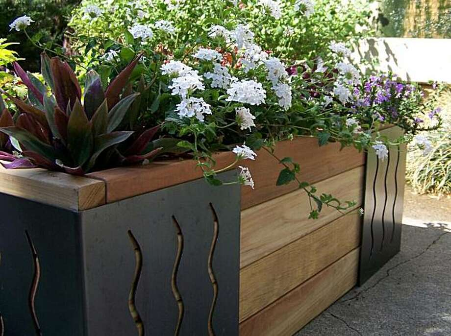 The M Brace can be used to create raised beds in under 30 minutes -- no tools required. Photo: Art Of The Garden