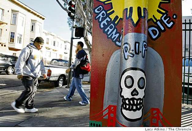People walk down 24th street between Portrero and Mission, Tuesday Oct. 21, 2008, an area know for it's culture, murrals and the norteno gang in San Francisco, Calif. Photo: Lacy Atkins, The Chronicle