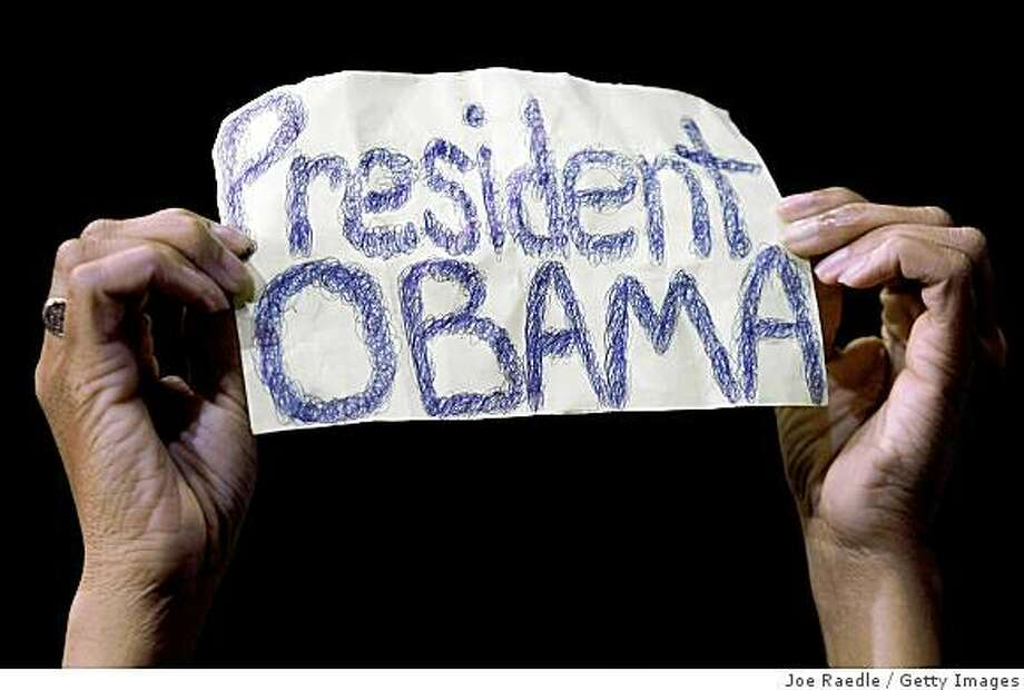RICHMOND, VA- OCTOBER 22: A supporter holds up a sign as Democratic presidential nominee U.S. Sen. Barack Obama (D-IL) speaks during a campaign event at the Richmond Coliseum  October 22, 2008 in Richmond, Virginia. Obama continues to campaign as Election Day begins to draw near as he runs against his Republican challenger, Sen. John McCain  (Photo by Joe Raedle/Getty Images) Photo: Joe Raedle, Getty Images