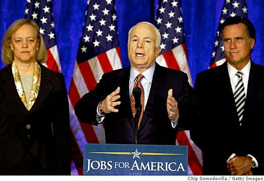 CLEVELAND - OCTOBER 27:  Republican presidential nominee John McCain makes a statement after meeting with his economic advisors, including Ebay CEO Meg Whitman (L) and former Massachusetts Gov. Mitt Romney (R), at the Renaissance Hotel October 26, 2008 in Cleveland, Ohio. With less than two weeks left before the U.S. presidential election, McCain has maintained that lowering taxes will help create jobs, and spoke of a plan to keep Americans in their homes despite the panic created by the collapse of the mortgage markets.  (Photo by Chip Somodevilla/Getty Images) Photo: Chip Somodevilla, Getty Images