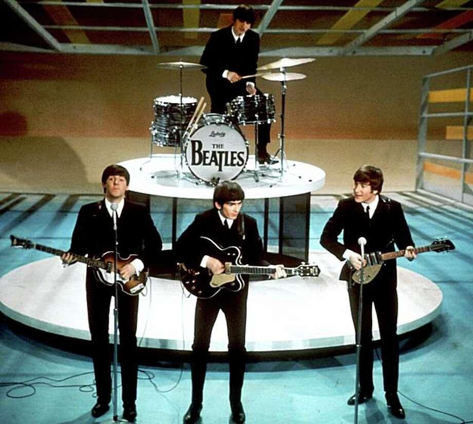 "The Beatles perform on the ""Ed Sullivan Show"" on Feb. 9, 1964. Photo: AP, File"