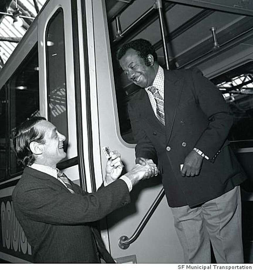 Supervisopr Harvey Milk, left, with Municipal Railway chief Curtis Green on a city streetcar in 1978. Photo: SF Municipal Transportation