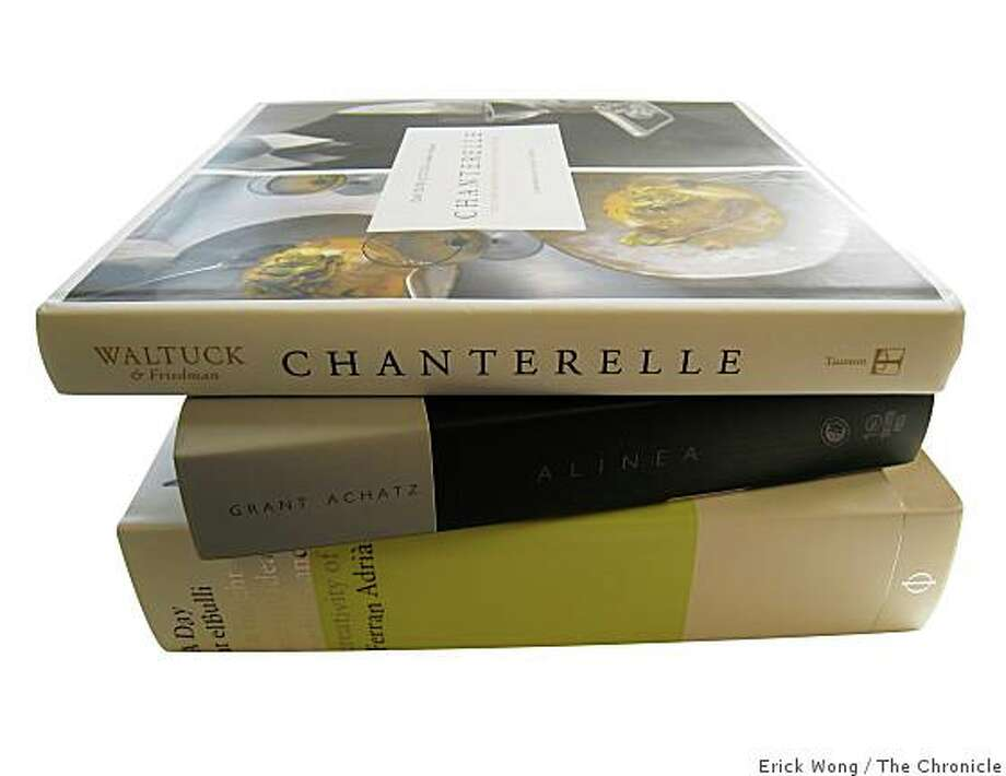 Cookbooks from top: Chanterelle, Alinea and A Day at elBulli. Photo: Erick Wong, The Chronicle