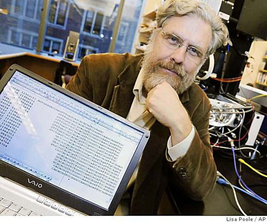 In his lab at the Harvard Medical School in Boston, George Church, Harvard Medical School Genetics professor, shows DNA sequence data for Dr. John Halamka, chief information officer,  following a news conference on Monday, Oct. 20, 2008 where a group of mostly scientists and researchers said they will post their medical records and DNA sequence of some of their own genes online for the sake of research. Both George Church and Dr. Halamka are part of the group that plan to post their medical and DNA sequence of some of their own genes online. (AP Photo/Lisa Poole) Photo: Lisa Poole, AP