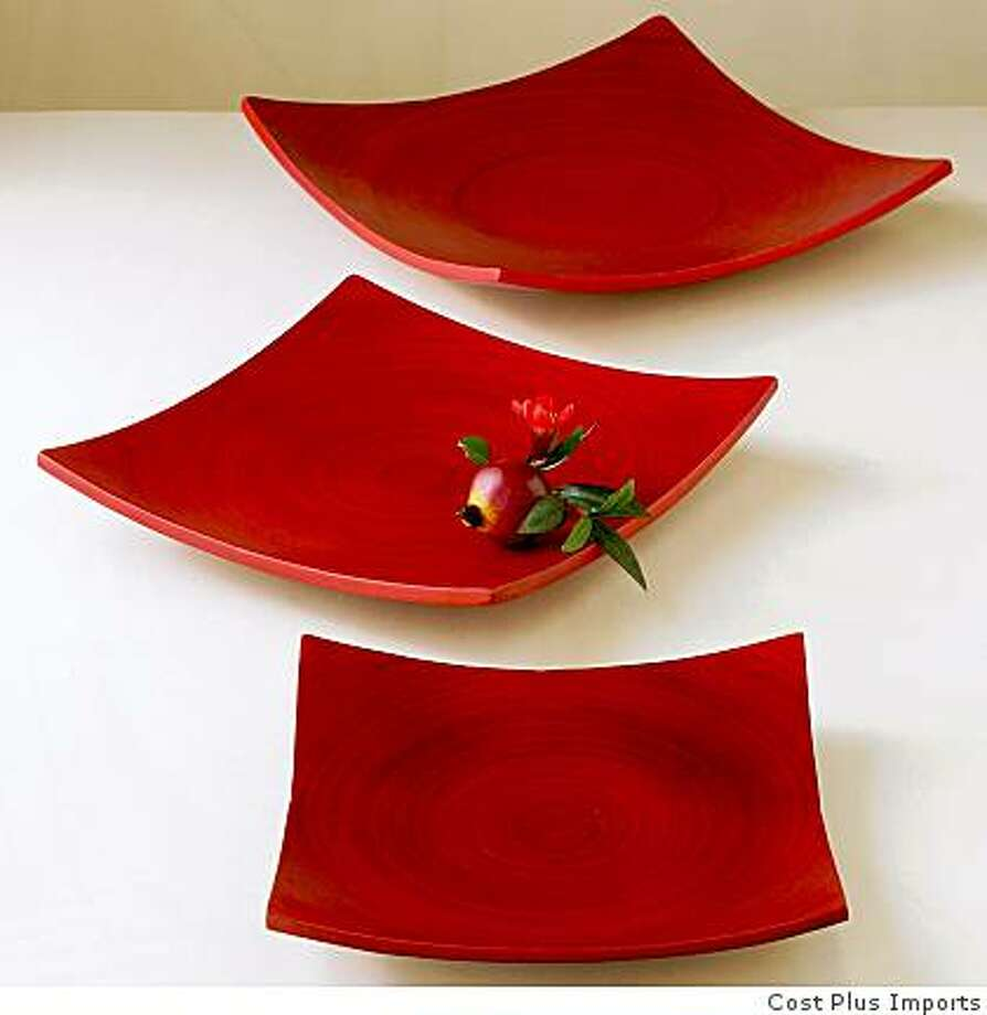 Red bamboo plates, sold in set of our up to $51.96 based on size, Cost Plus Photo: Cost Plus Imports