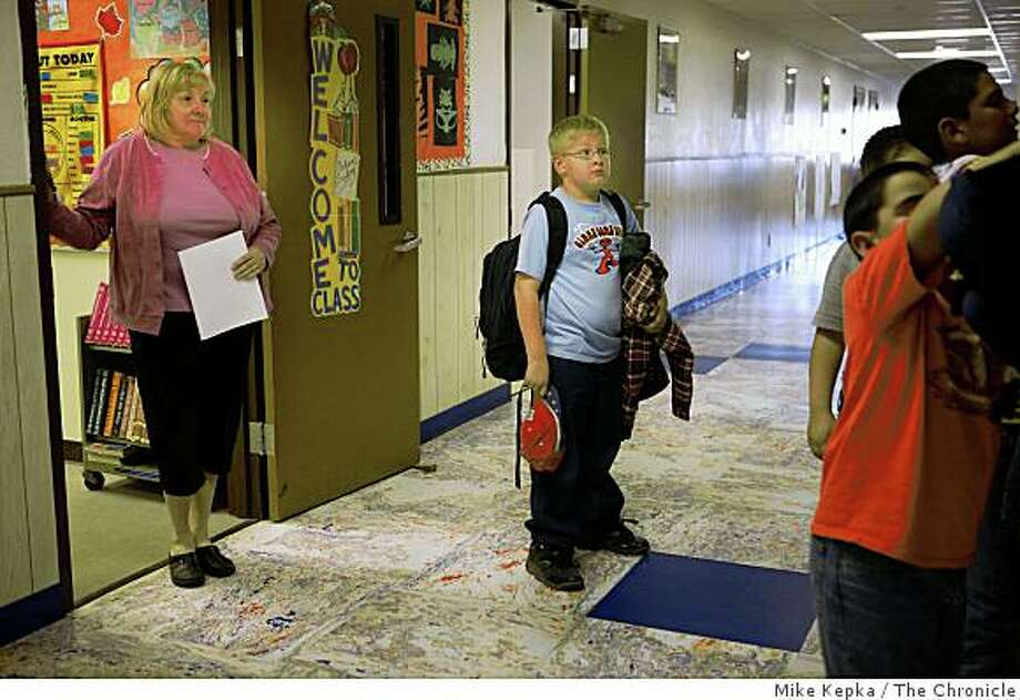 "McCain supporter, Roberta Winrod, 50, who is the only elementary school teacher at Austin Schools, watches as her son Ryan Winrod, 9, and his classmates prepare to leave for the day on Wednesday Oct. 13, 2008 in Austin,NV. With only 34 students at the school, her son has never had another teacher besides his mother. Windrod is worried that her school may close if government regulations restrict nearby mining operations. ""I thinks its a trickle down system,"" she says. Photo: Mike Kepka, The Chronicle"