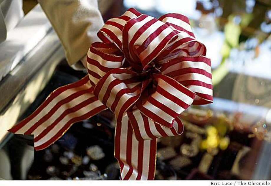 Big bow from Christmas wire-rimmed ribbon at Paulette Knight,'s Ribbonerie who has hundreds of ribbons to choose from. Photo: Eric Luse, The Chronicle