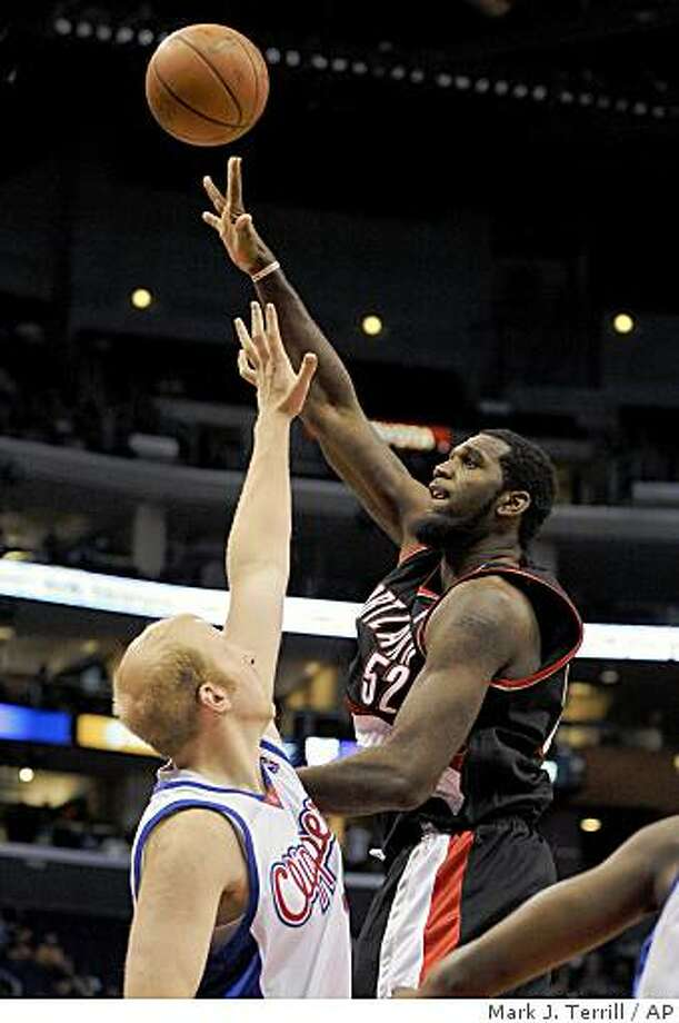 Blazers center Greg Oden puts up a shot as Los Angeles Clippers center Chris Kaman defends during the first half on Wednesday, Oct. 22, 2008, in Los Angeles. Photo: Mark J. Terrill, AP