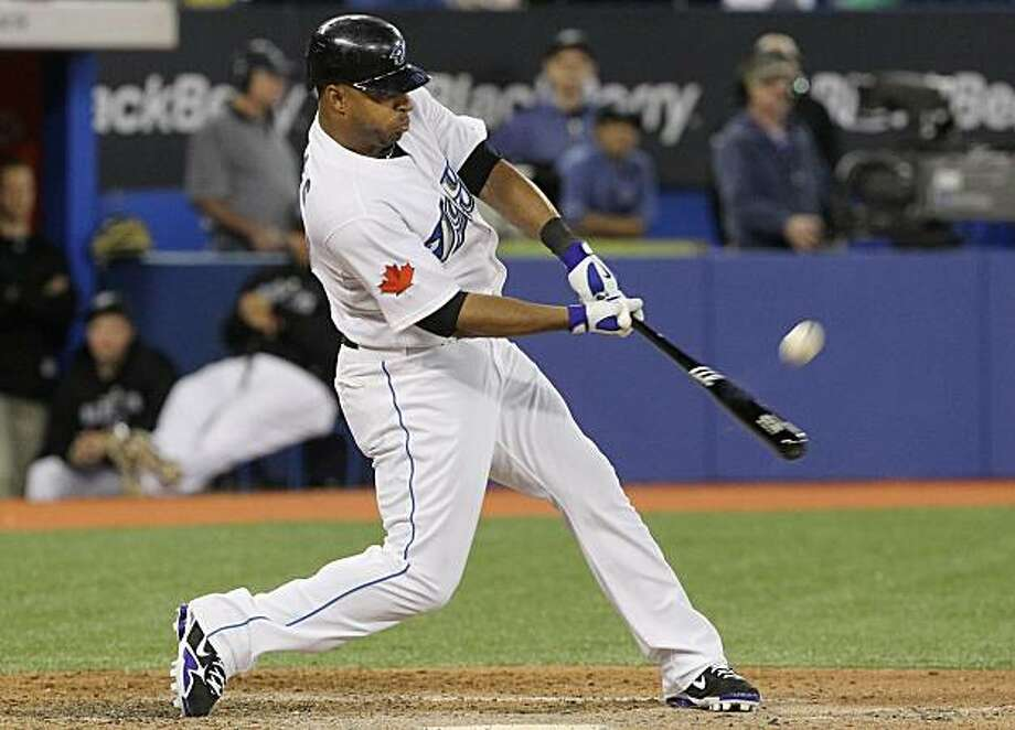 Toronto Blue Jays' Vernon Wells hits a three-run home run off of Texas Rangers pitcher Doug Mathis to put the Blue Jays ahead 11-9 during third-inning baseball game action in Toronto, Friday, May 14, 2010. Photo: Darren Calabrese, AP