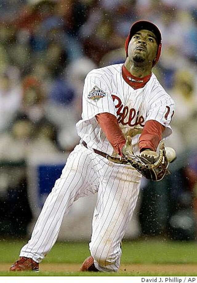 Philadelphia Phillies' Jimmy Rollins can't catch a ball hit by Tampa Bay Rays' Rocco Baldelli  during the fifth inning of Game 5 of the baseball World Series in Philadelphia, Monday, Oct. 27, 2008. (AP Photo/David J. Phillip) Photo: David J. Phillip, AP
