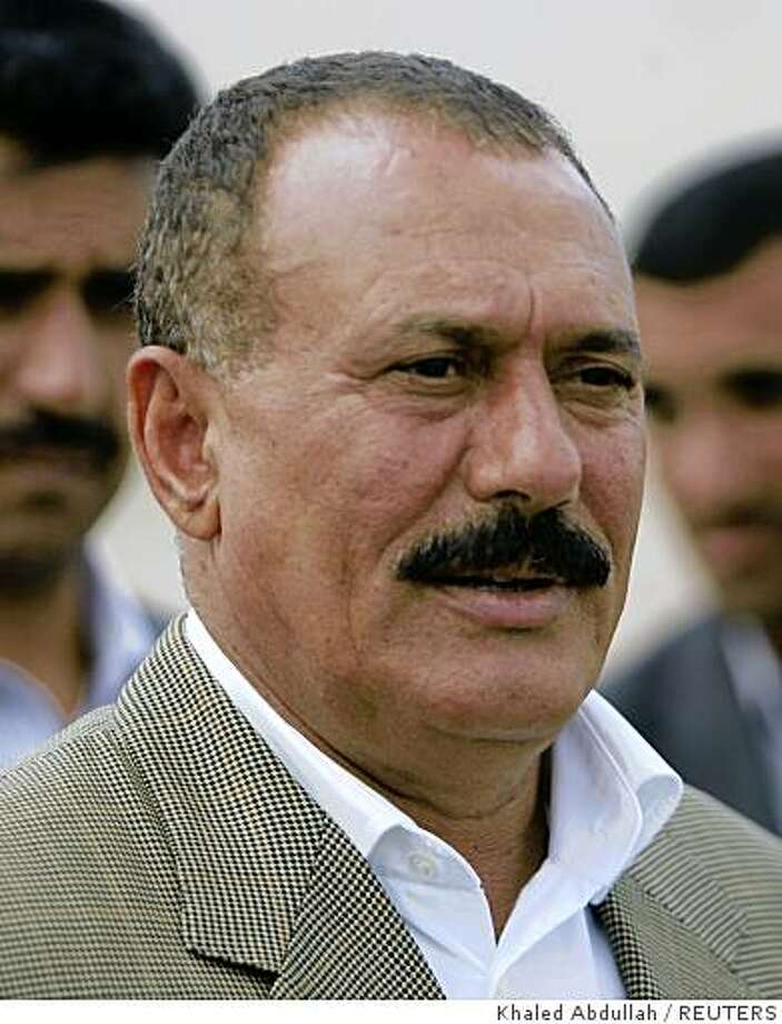 Yemeni President Ali Abdullah Saleh talks to reporters after his arrival to the southeastern city of Sayoun October 25, 2008 to oversee rescue and relief operations after floods lashed eastern parts of the Arab country. Floods killed 41 people and around 31 are missing in Yemen after torrential rain left swathes of the impoverished country under water, President Ali Abdullah Saleh said on Saturday.  REUTERS/Khaled Abdullah (YEMEN) Photo: Khaled Abdullah, REUTERS