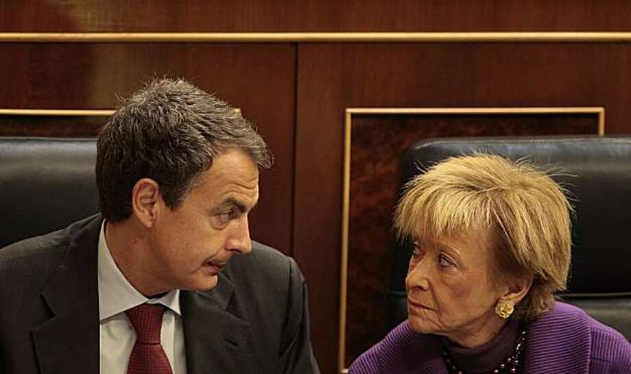 Spain's Prime Minister Jose Luis Rodriguez Zapatero, left, and Spain's first deputy Prime Minister Maria Teresa Fernandez de la Vega, right, are seen during a plenary session at the Spanish Parliament in Madrid Wednesday May 12, 2010. Spain's prime minister told parliament he will cut civil servants' salaries this year as part of a deficit-reduction plan to ease worries his country will slide into a debt crisis like that of Greece as part of a series of measures that also include a suspension in automaticincreases in retirement pensions, a drop in overseas aid and a reduction in government investment. Photo: Arturo Rodriguez, AP