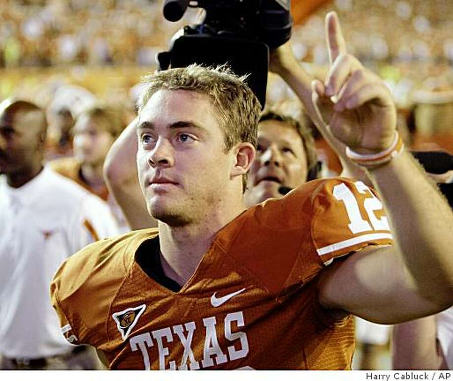 Texas quarterback Colt McCoy walks off the field after the team's NCAA football game against Missouri in Austin, Texas, Saturday, Oct. 18, 2008. Texas won 56-31.  (AP Photo/Harry Cabluck) Photo: Harry Cabluck, AP