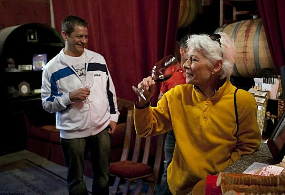 Adrianna Trimble, right, and Mario Leon, left, samples wines at Page Mill Winery in Livermore, Calif. on Sunday, Mar. 14, 2010. Photo: Adam Lau, Special To The Chronicle