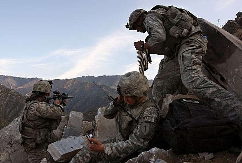 Forward observer Spc. Kyle Stephenson (C), calls in mortars during a firefight with Taliban insurgents October 28, 2008 in the Korengal Valley in eastern Afghanistan. American forces from 2nd Platoon Viper Company of the 1-26 Infantry had occupied a strategic mountaintop when they were fired upon by Taliban militia. No Americans were injured in the fight and Taliban casualties were unknown. The Korengal Valley is the site of some of the heaviest fighting of the Afghan war. Photo: John Moore, Getty Images
