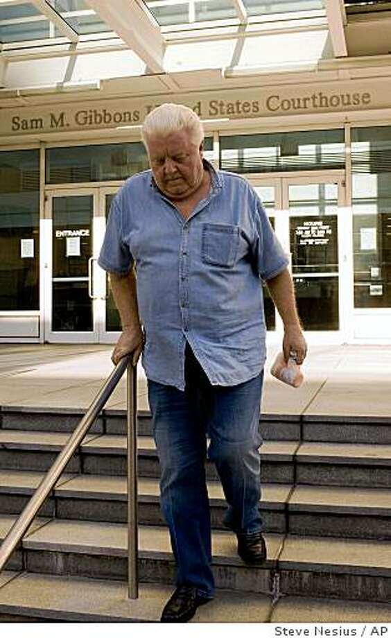 Former Chicago Police Department commander Jon Burge leaves the Federal Courthouse after he was released from custody Tuesday afternoon, Oct. 21, 2008 in Tampa, Fla. The former high-ranking Chicago police official was arrested Tuesday on charges he lied when he denied that he and detectives under his command tortured murder suspects, federal officials said. (AP Photo/Steve Nesius) Photo: Steve Nesius, AP
