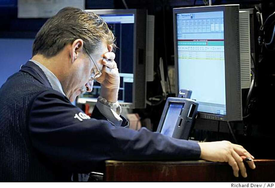 A trader works on the floor of the New York Stock Exchange Tuesday, Oct. 21, 2008. (AP Photo/Richard Drew) Photo: Richard Drew, AP