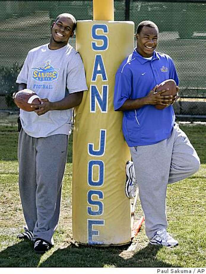 San Jose State football players Carl Ihenacho, left, and his brother, Duke Ihenacho pose on the practice field in San Jose, Calif., Wednesday, Oct. 22, 2008. Photo: Paul Sakuma, AP